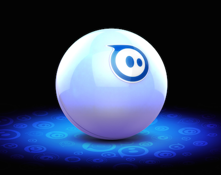 sphero 2.0, a small white robotic ball, lit by a blue light